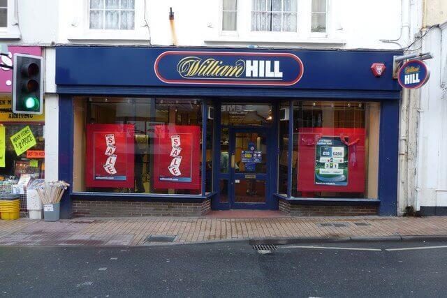 william Hill profits slump